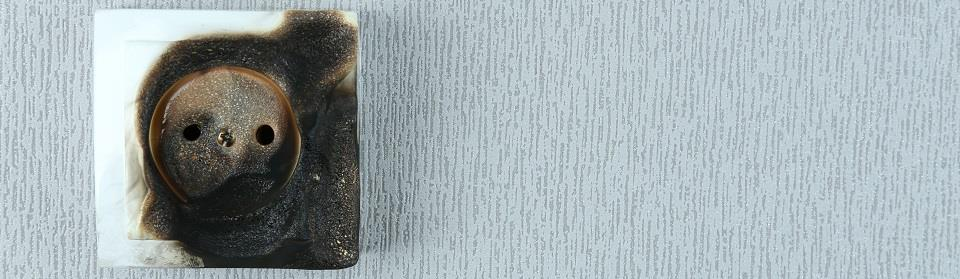 Verbrand stopcontact stroomstoring